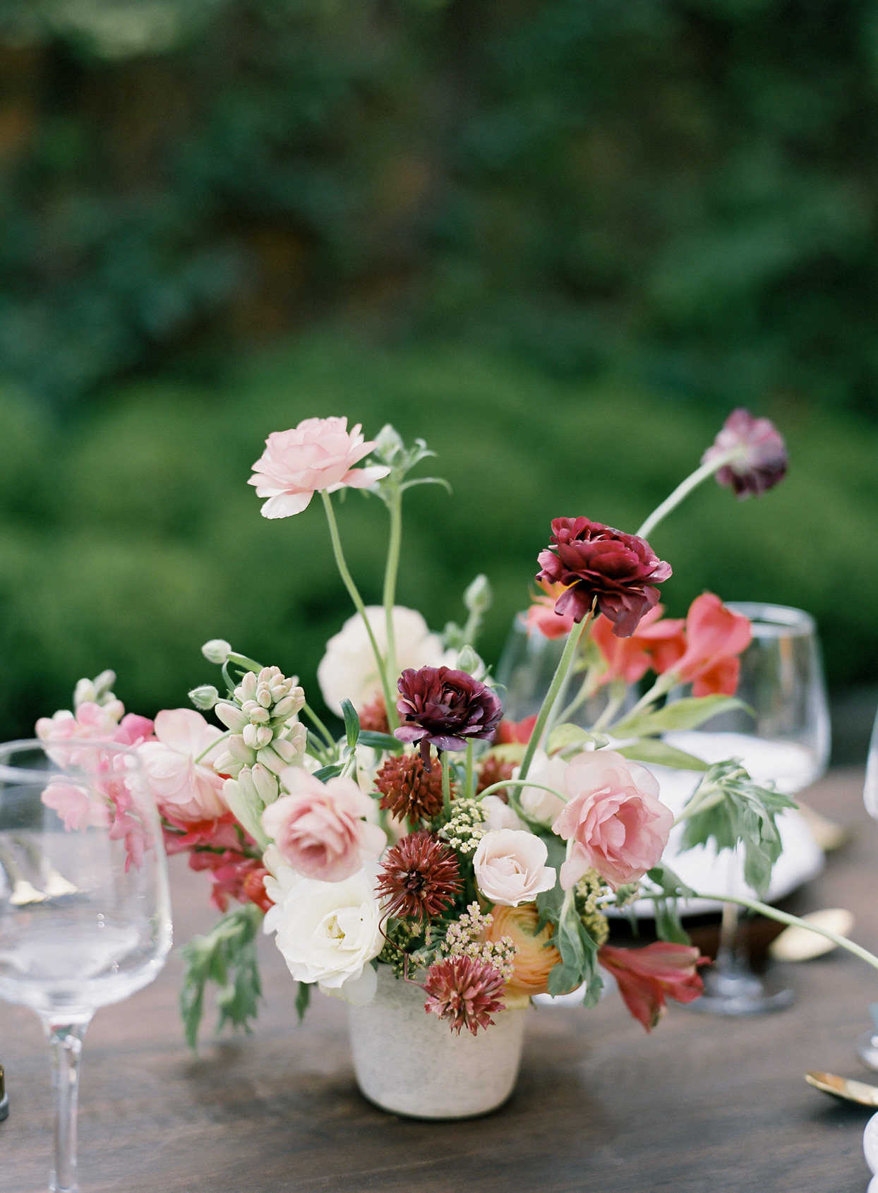 pink tones floral bouquet on reception table
