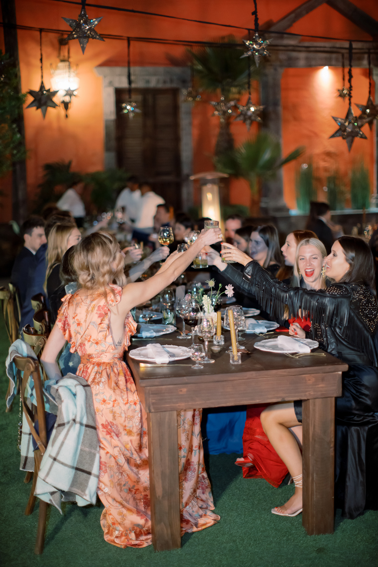 guests toasting at outdoor wedding reception