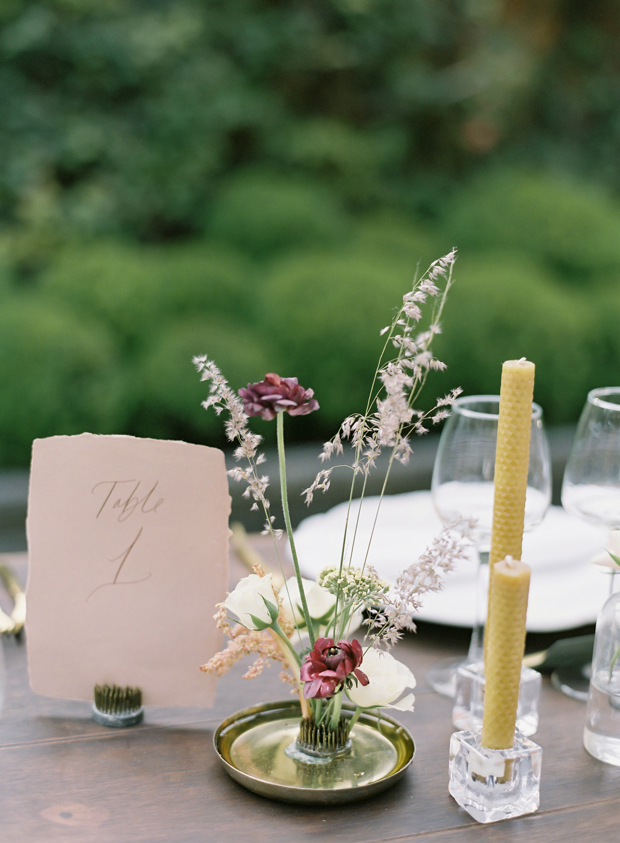 small floral wedding centerpiece on table