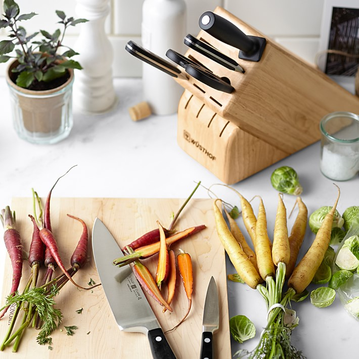 vegetables and knife set on a cutting board