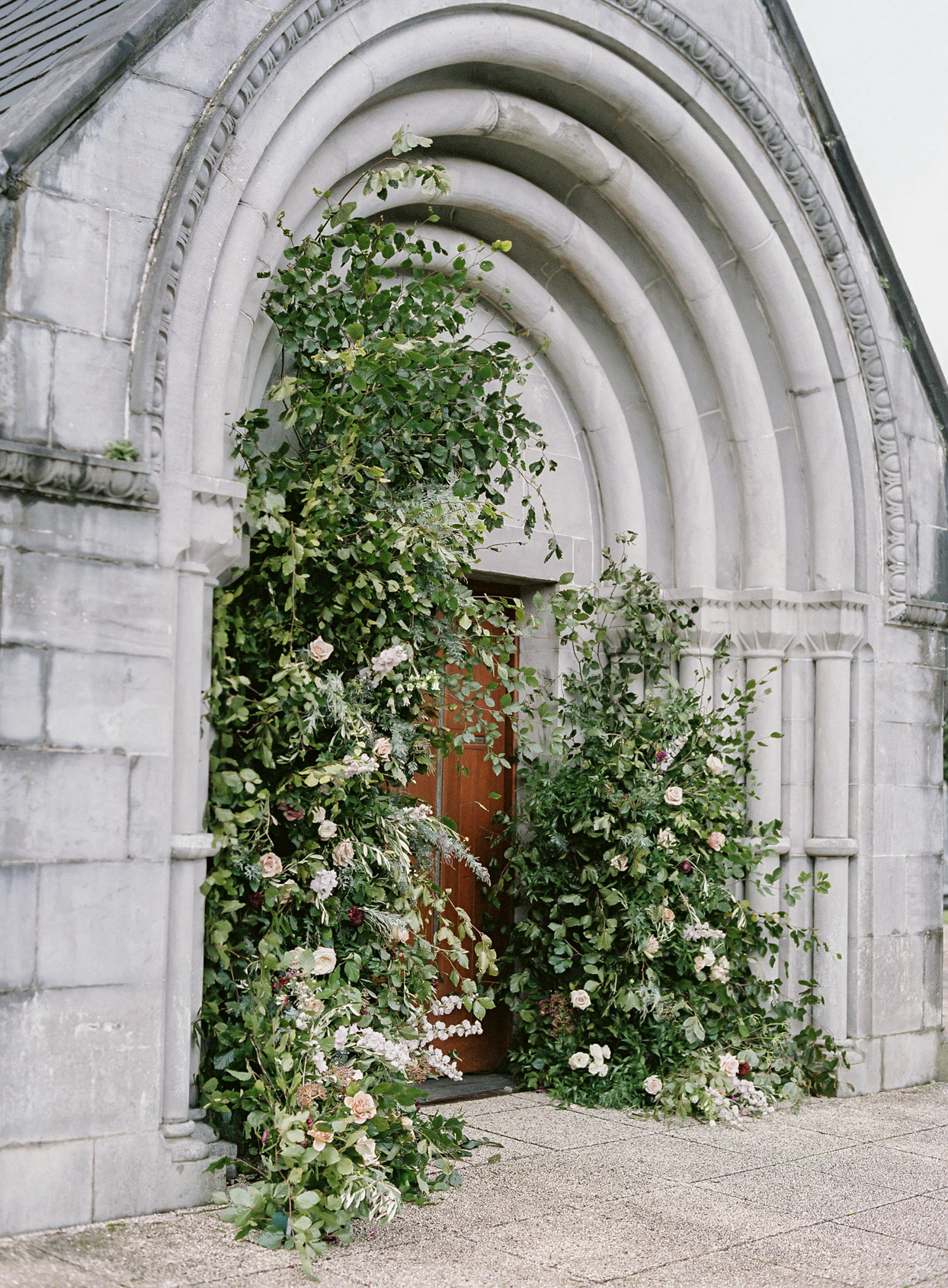 greenery arch on door to church