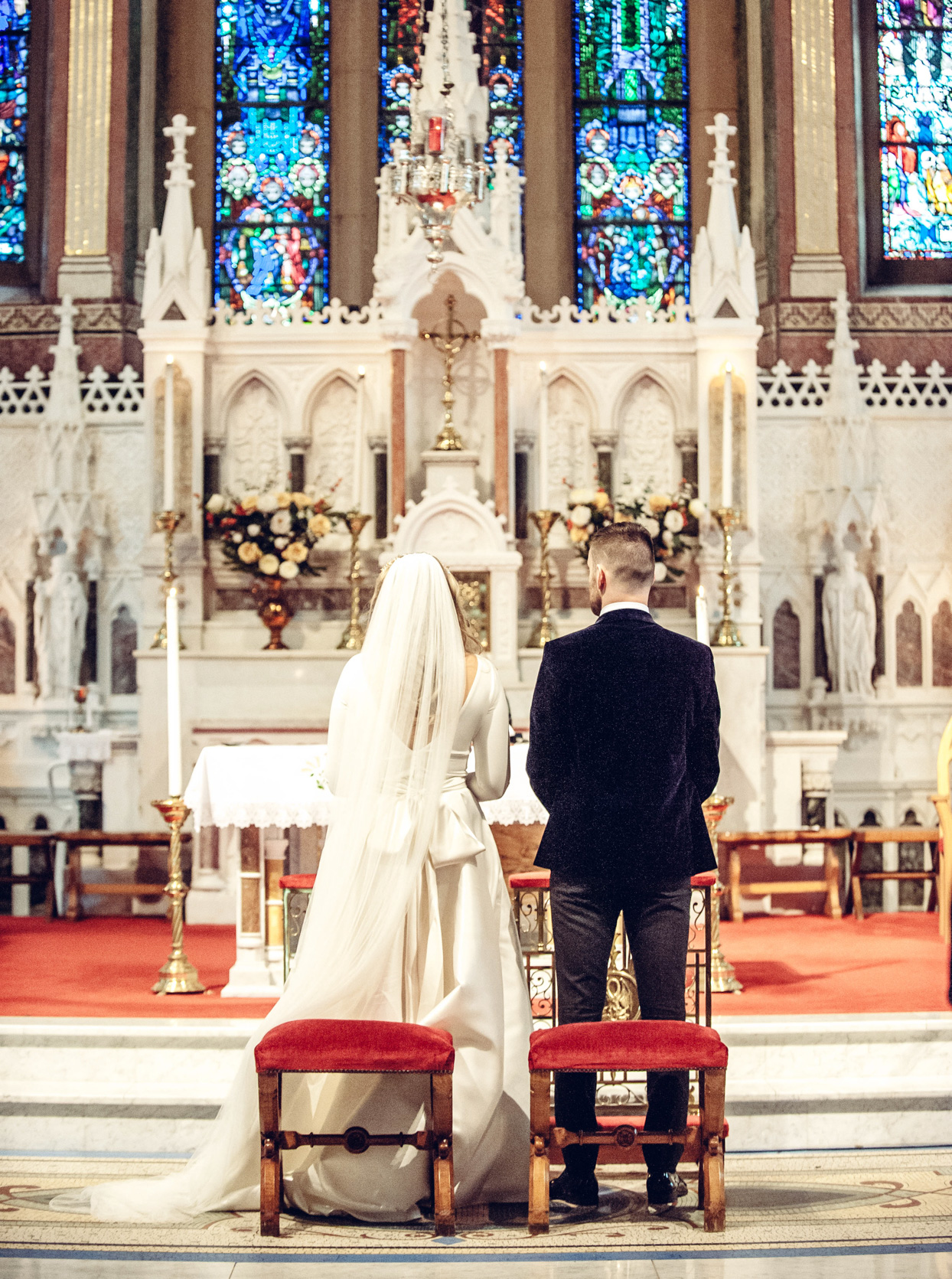 bride and groom in chapel for traditional wedding ceremony