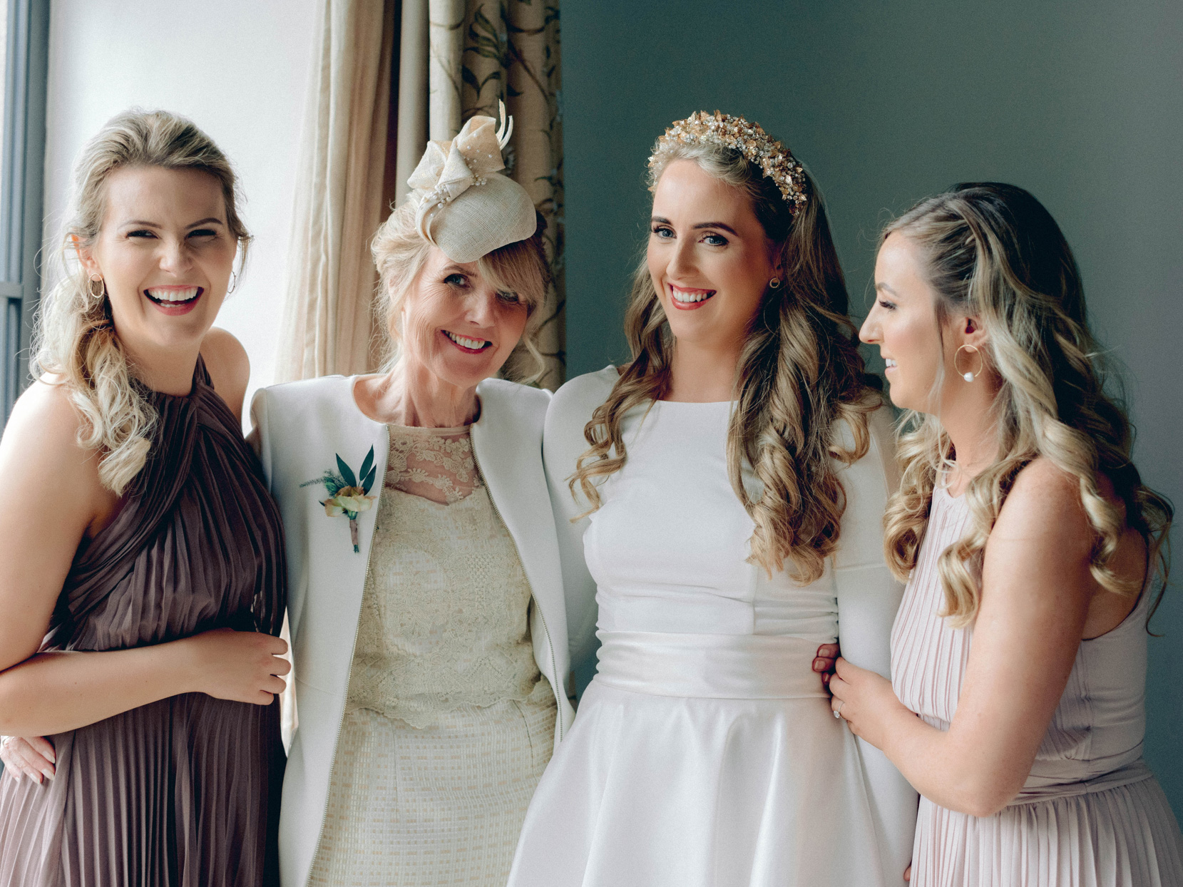 bride and wedding women smiling together