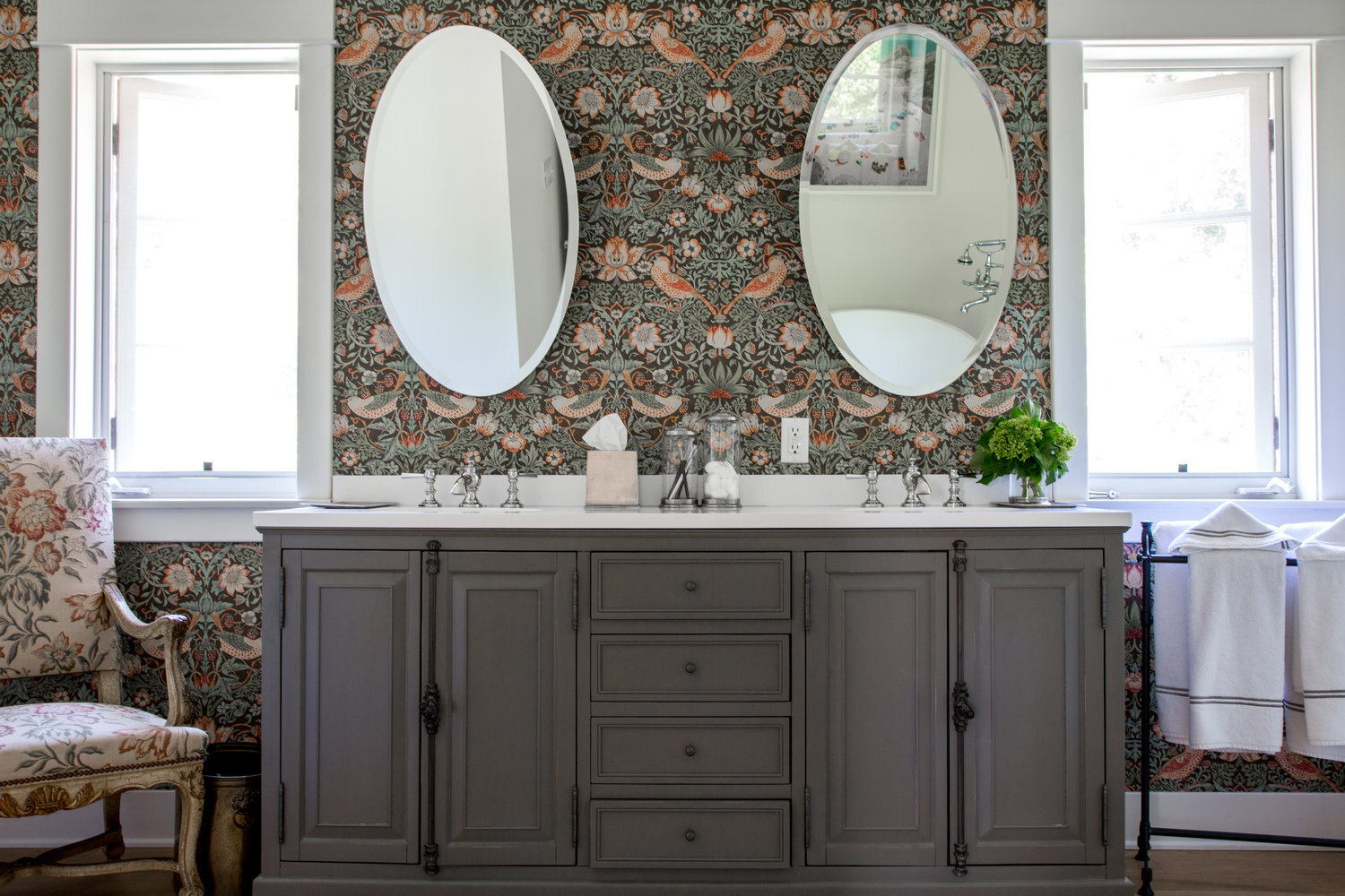 floral-patterned bathroom with double sink vanity