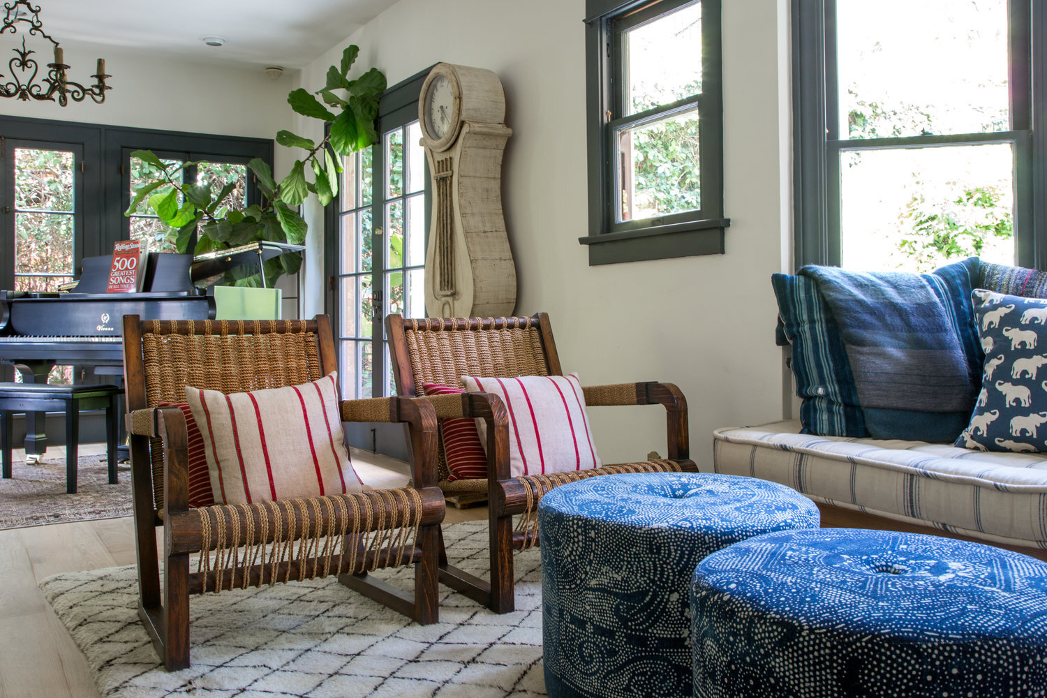 multi-colored living room with woven armchairs