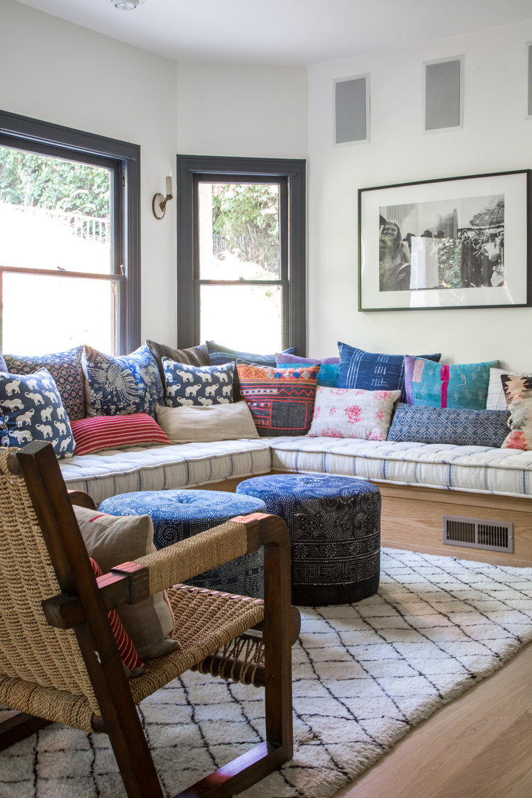 wraparound bench embellished with colorful throw pillows