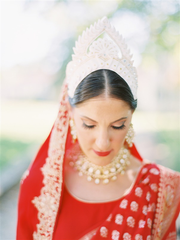 bride in red attire with hindu headpiece