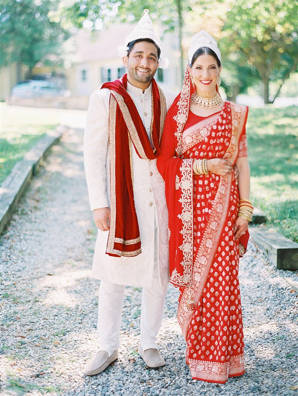 wedding couple in traditional red hindu wedding attire