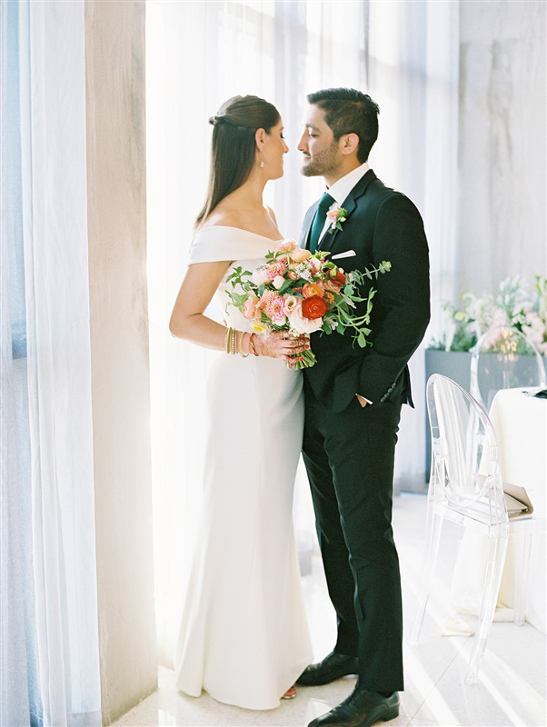 wedding couple in black and white apparel by window