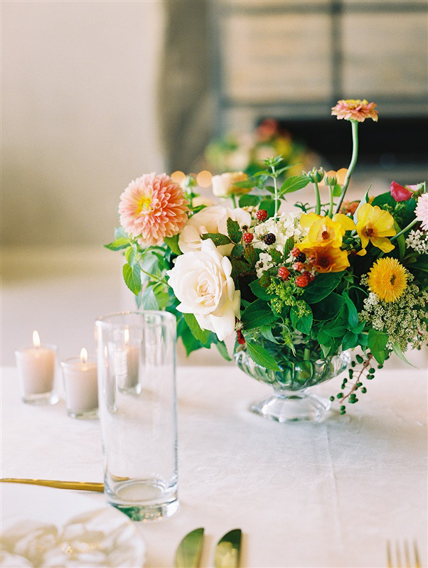 warm tones floral bouquet on white linen table