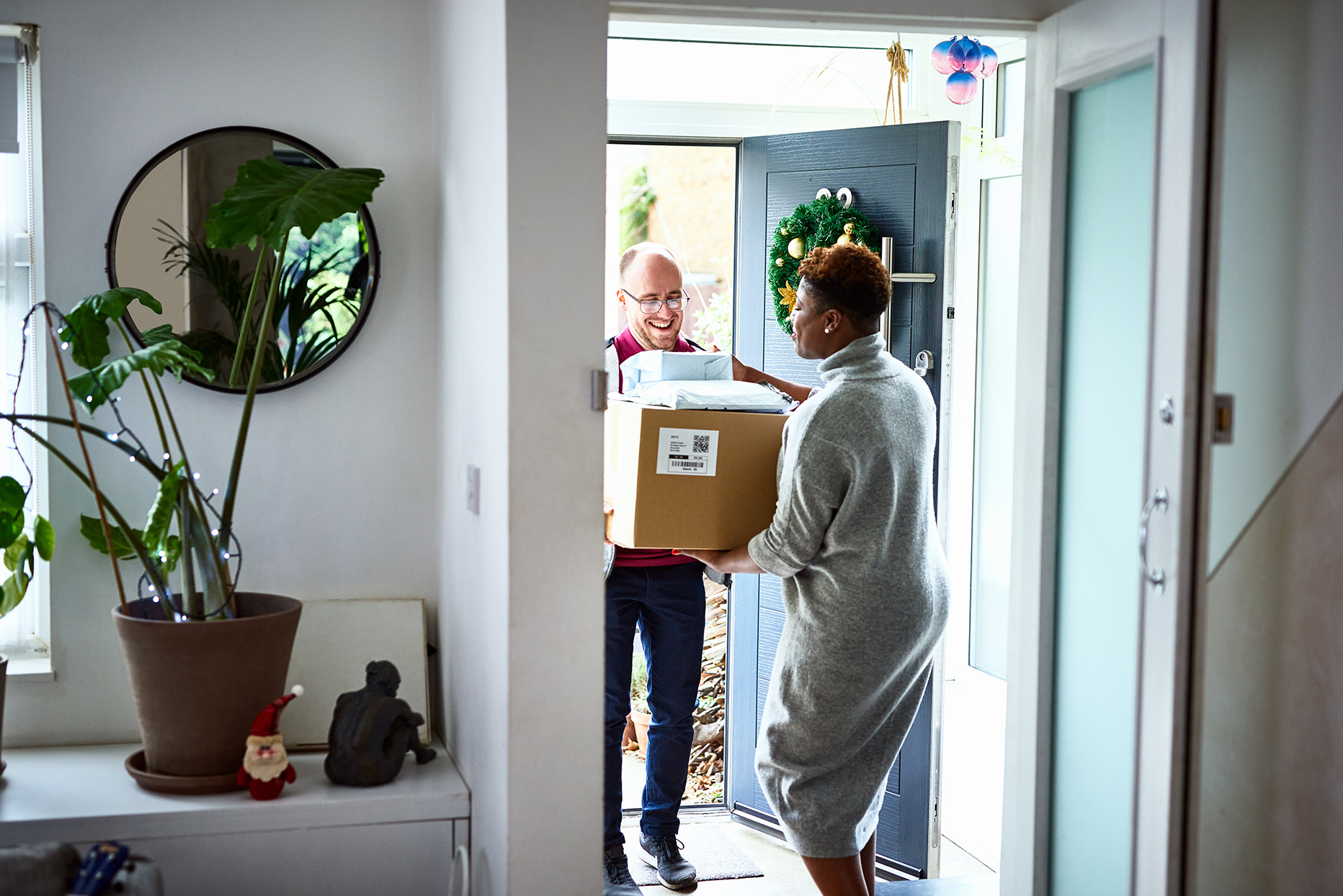 person delivering package to home