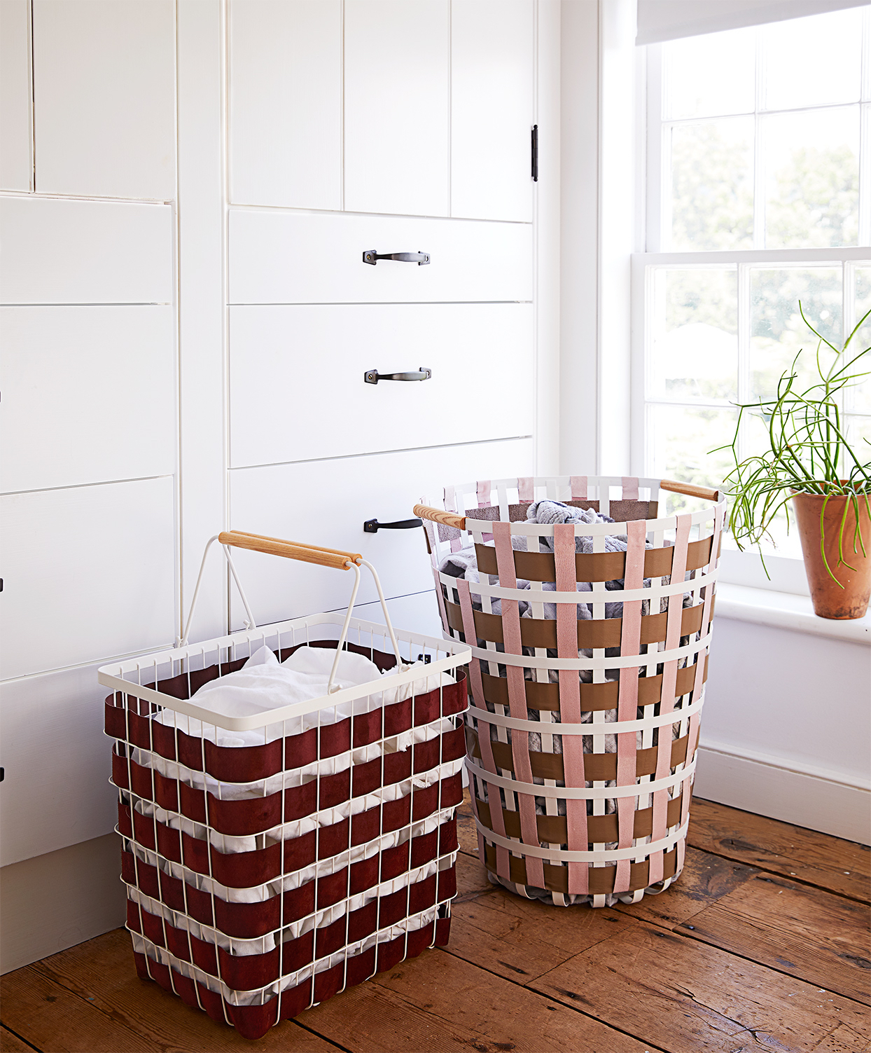 a pair of woven laundry hampers