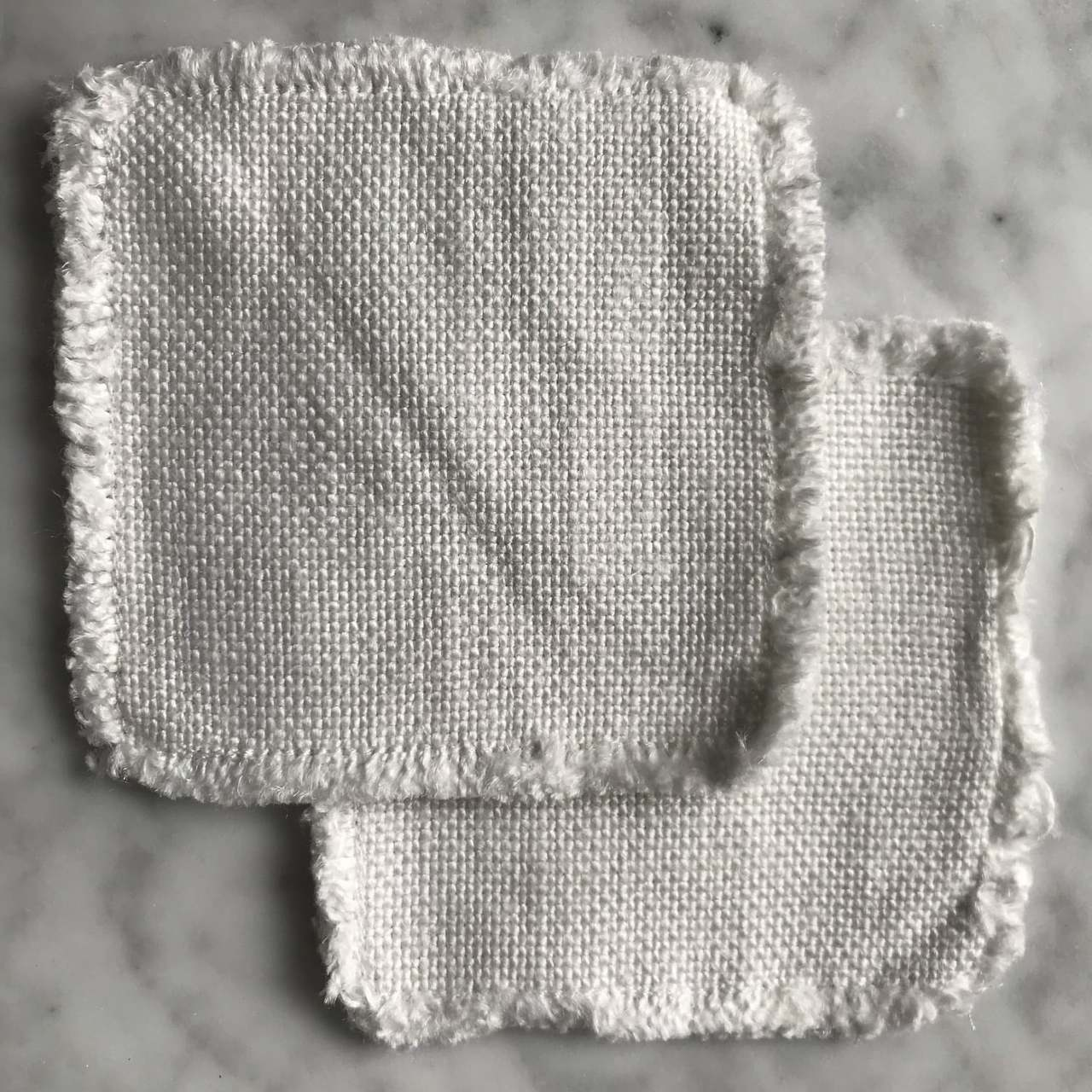 linen coasters on marble table