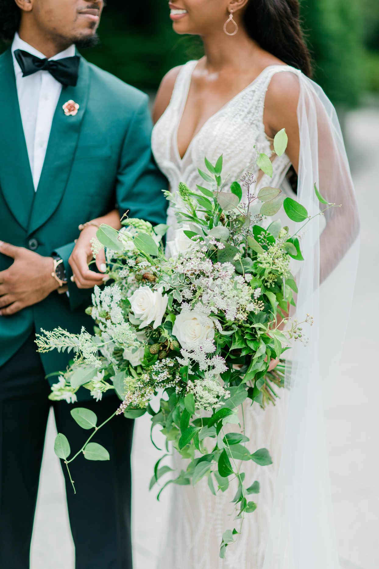 bridal bouquet of greenery and white roses