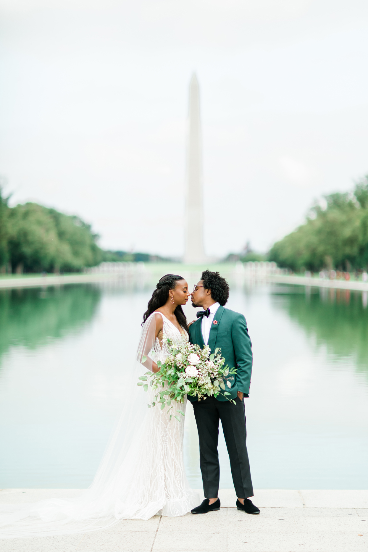 bride and groom in front of washington monument