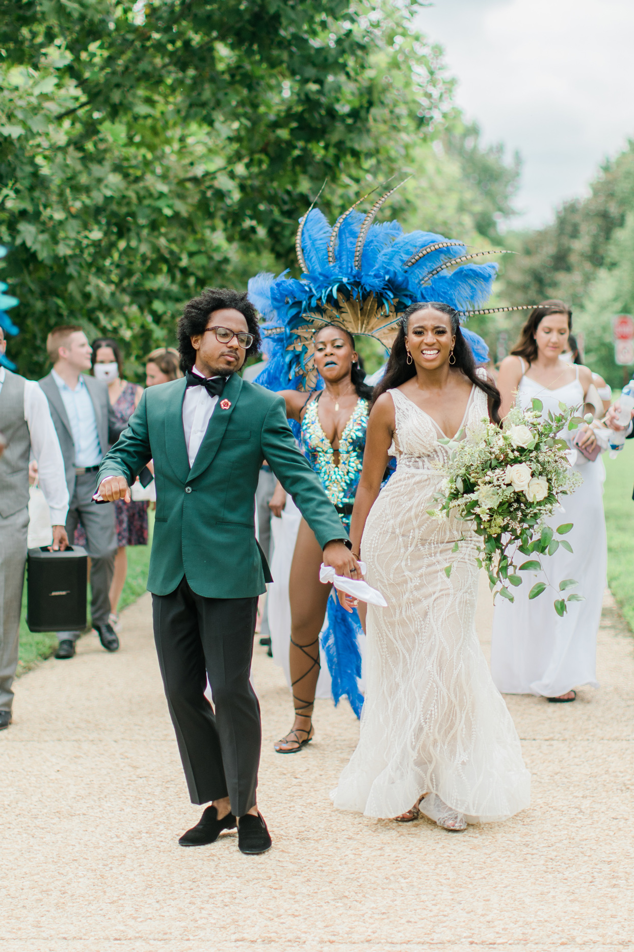 wedding soca parade with blue-feathered dancers