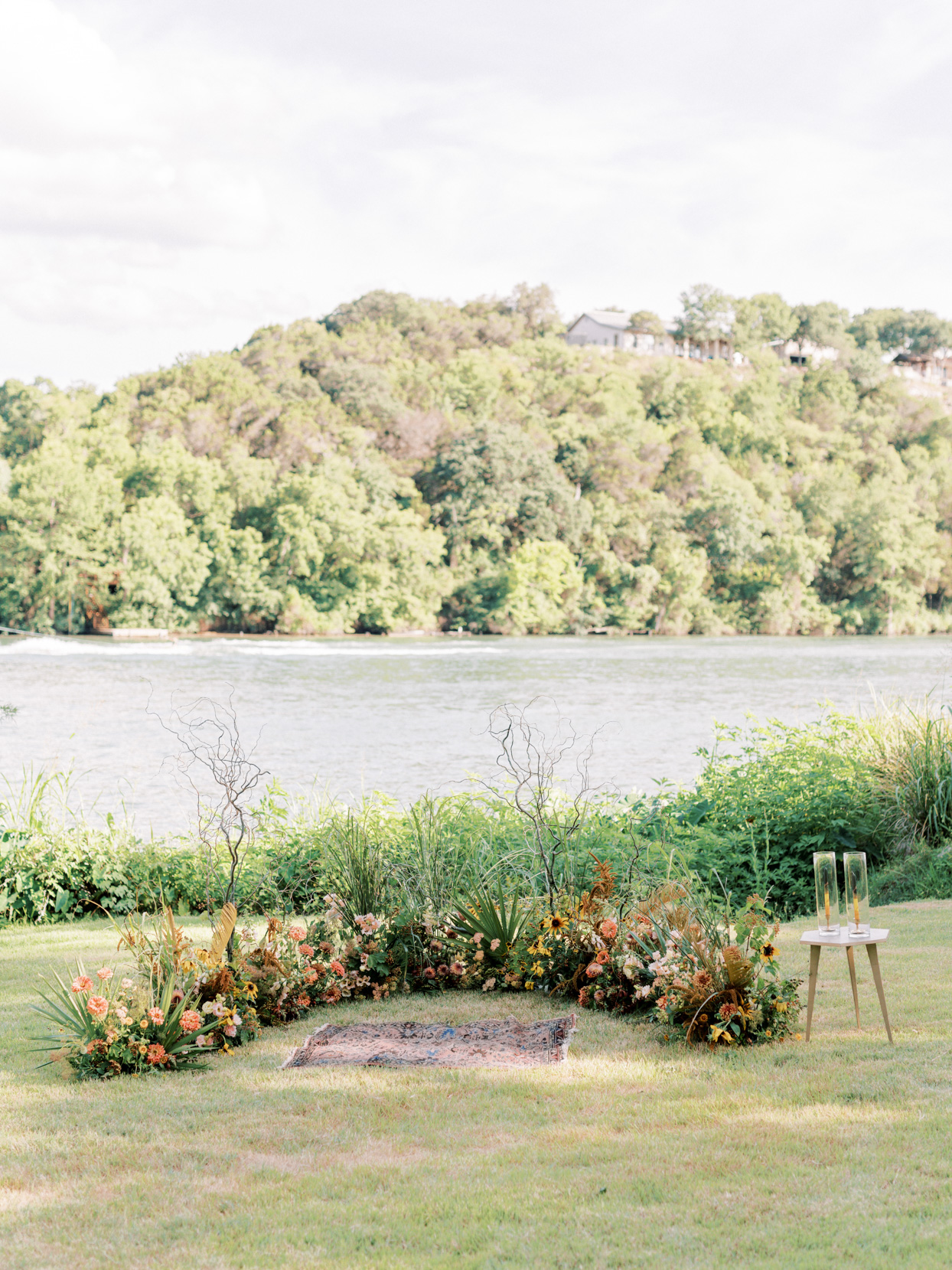wedding ceremony setting with ground arch by water