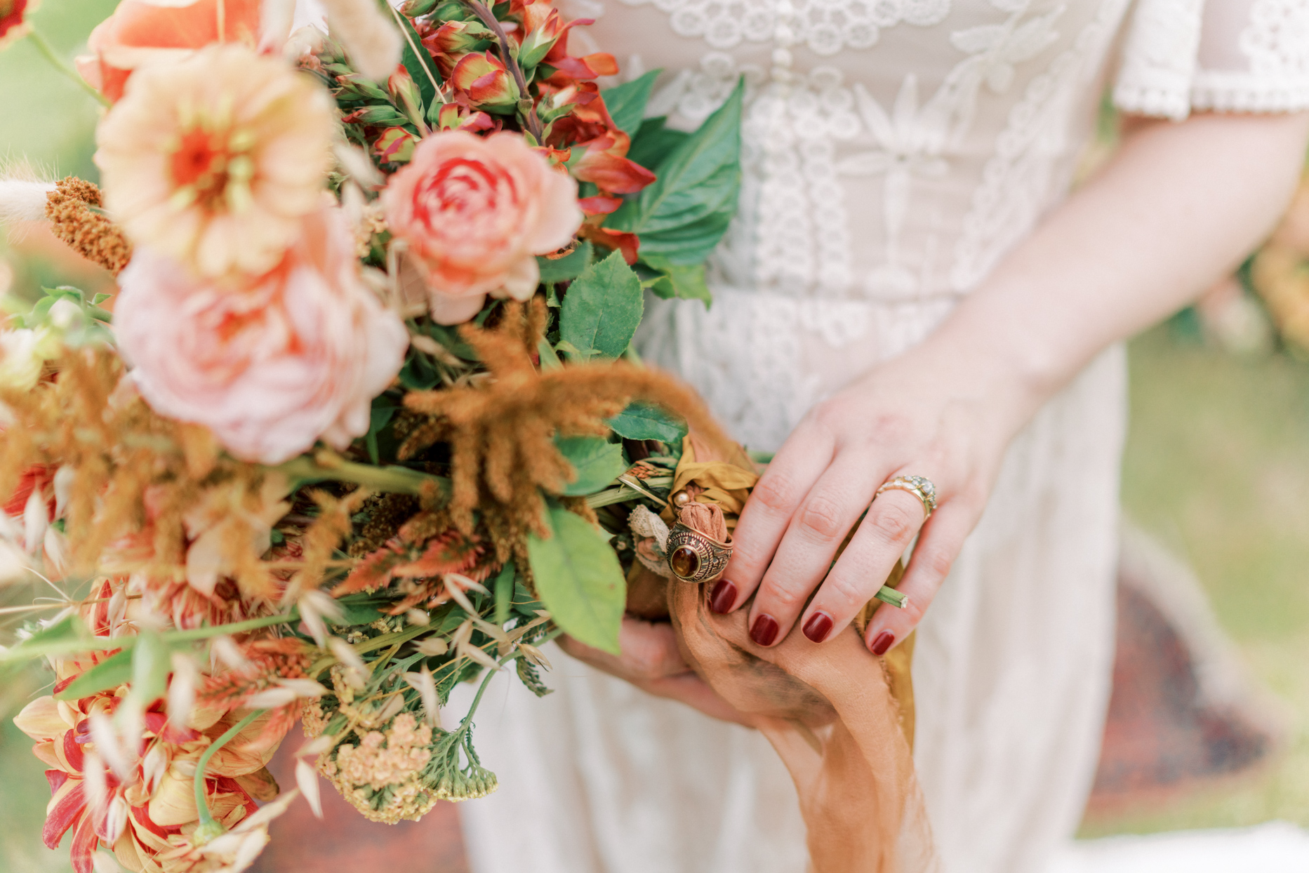 bride holding bouquet with class ring attached