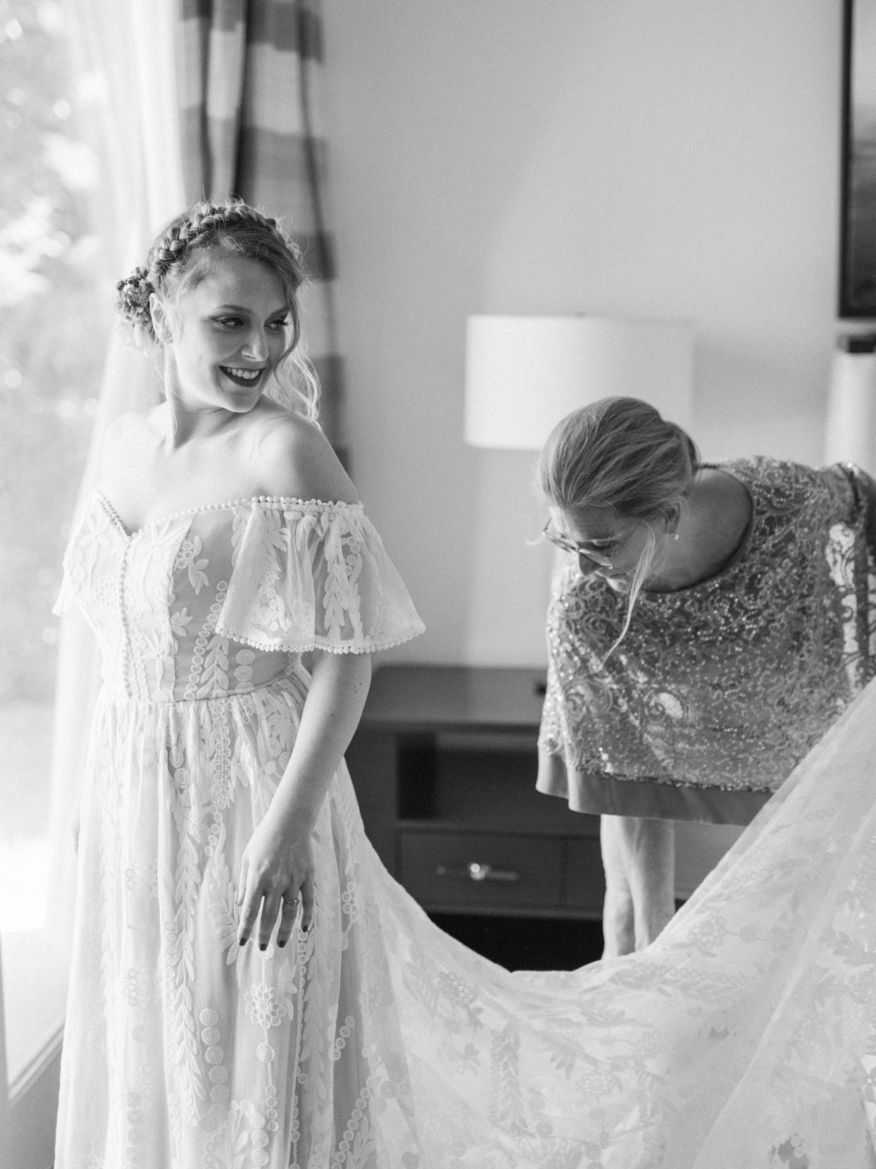 bride in lace overlay dress getting ready with mother