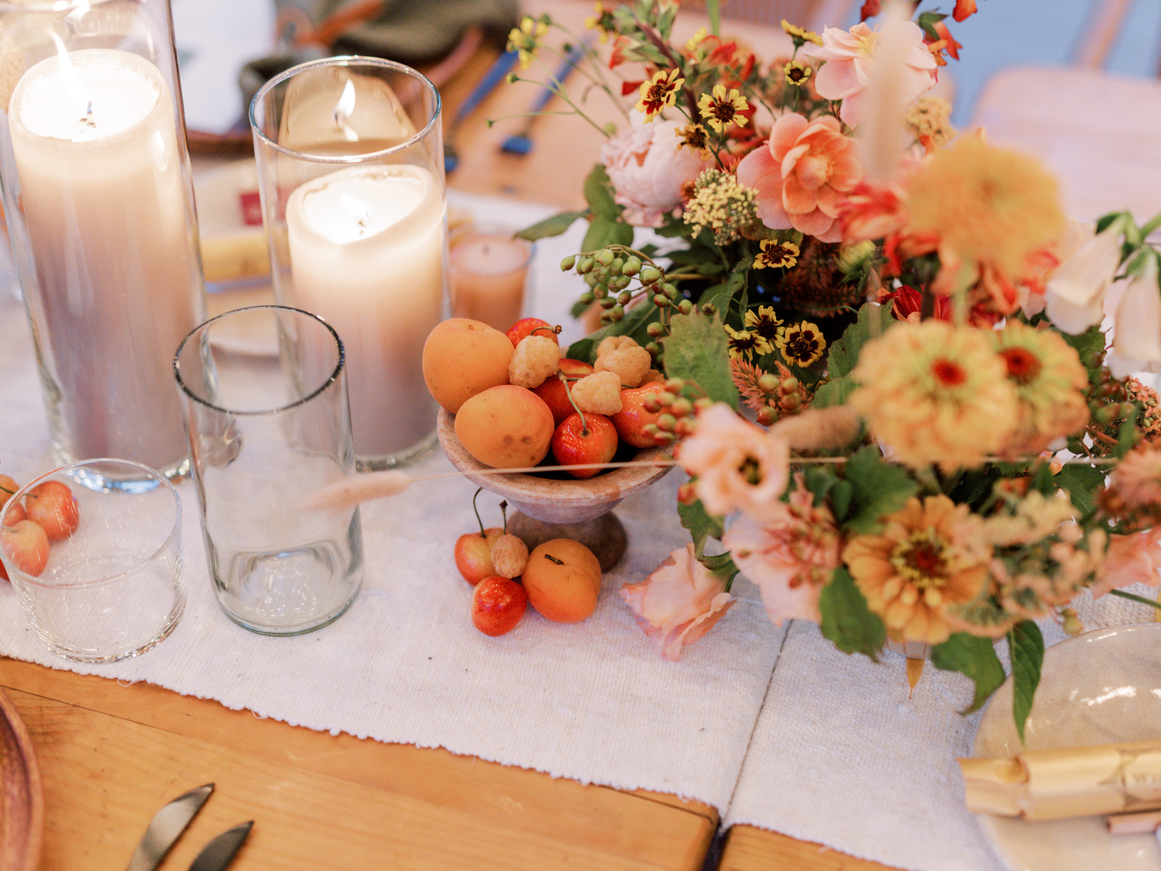 orange and yellow wedding floral and fruit centerpieces