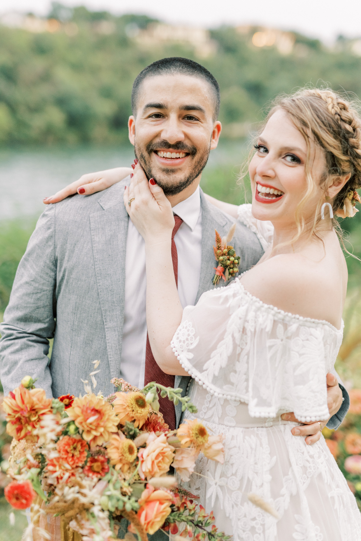 wedding couple in gray and warm tones posing for portrait