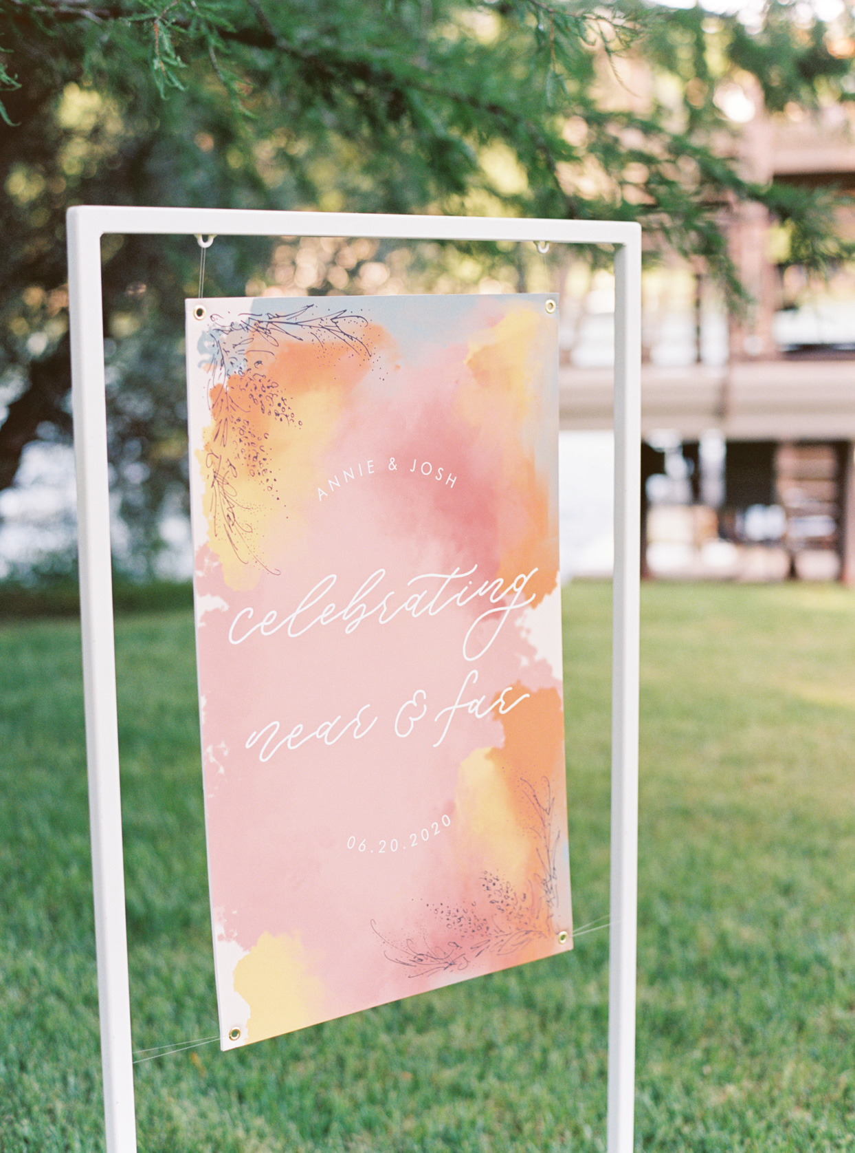 pastel pink and orange watercolor appearance wedding sign