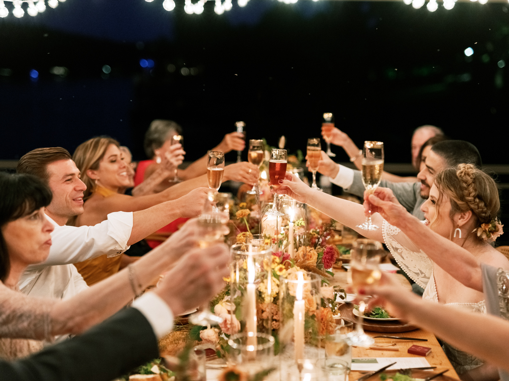 wedding guests toasting champagne during outdoor reception