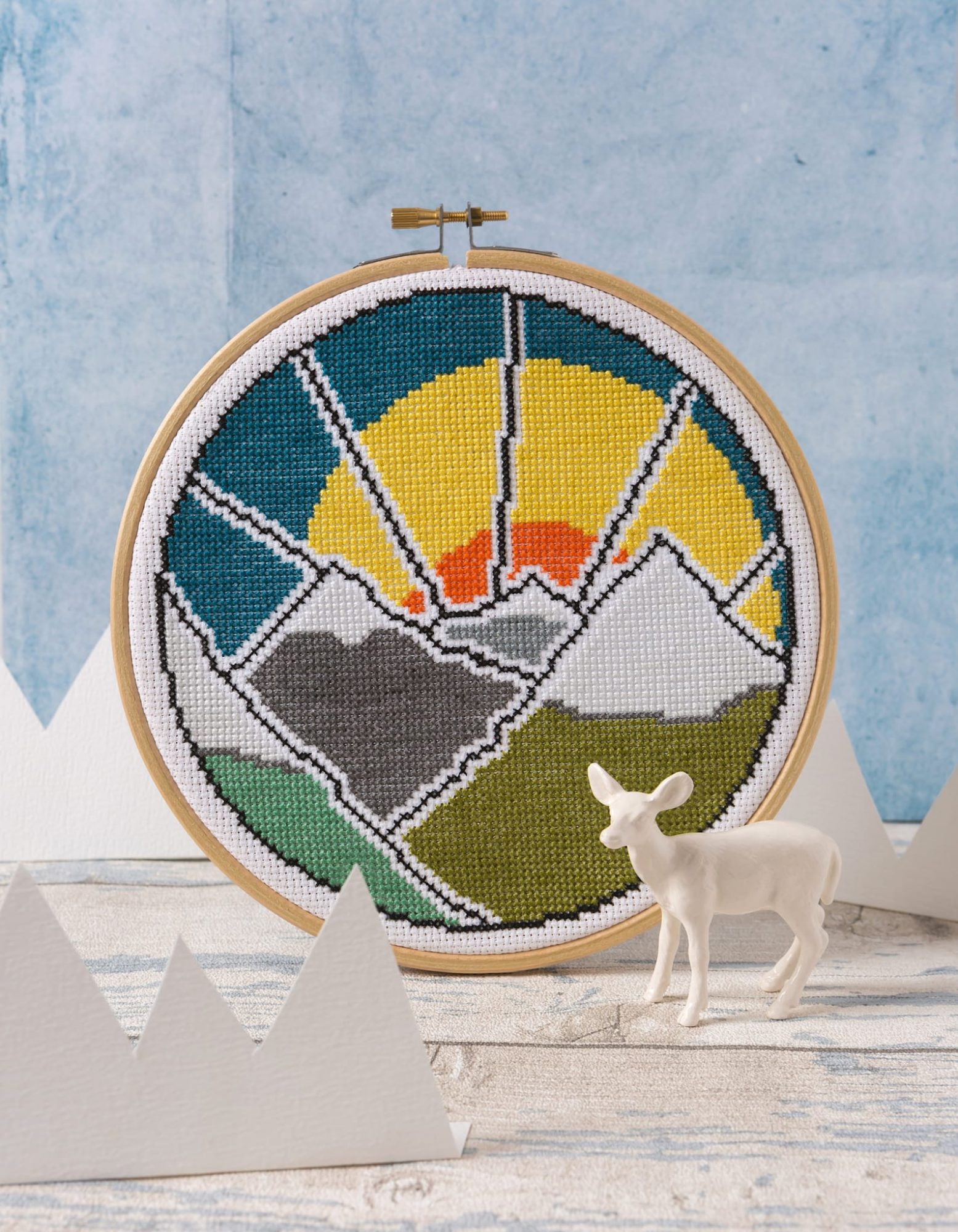 sunset behind snow-capped mountains cross stitch