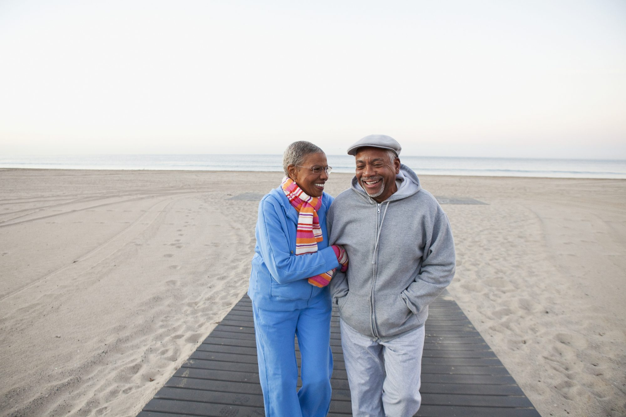 Retired Couple Walking on the Beach