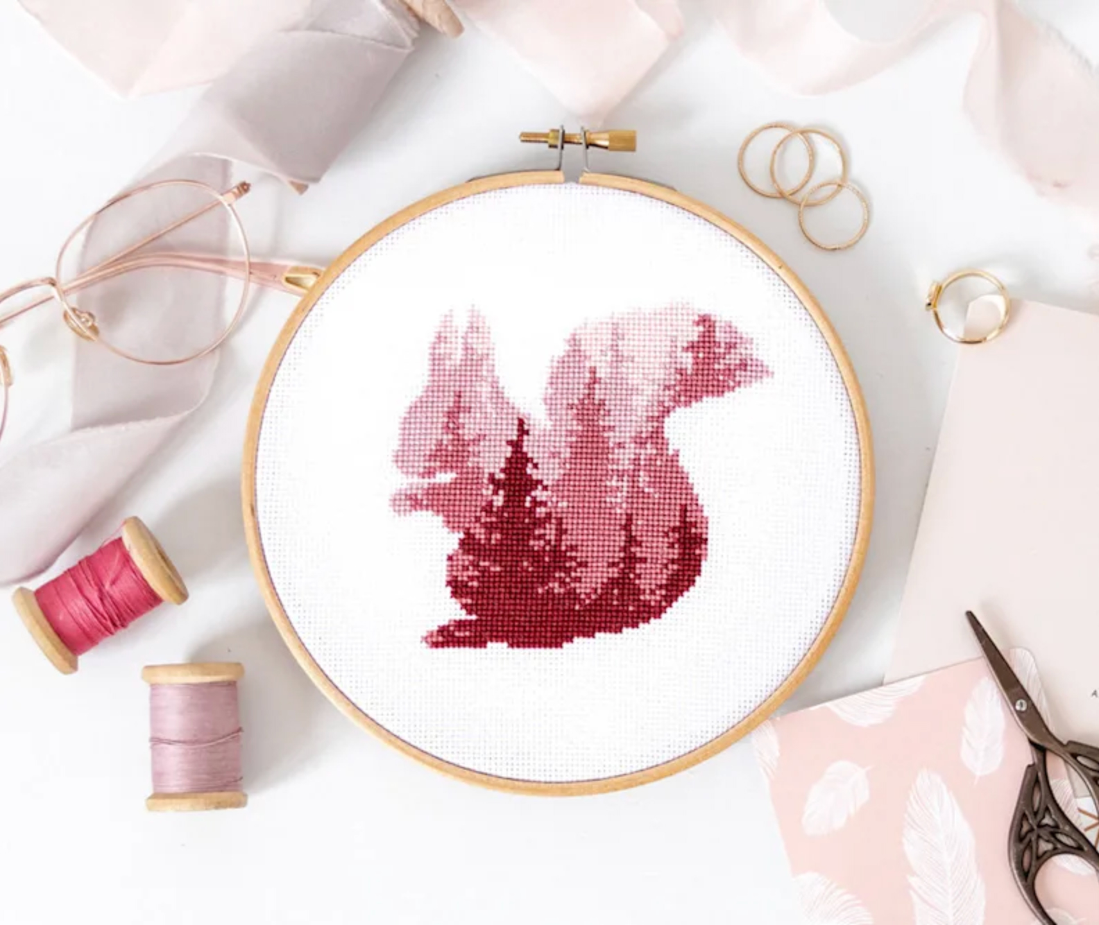 pink tree pattern in shape of a squirrel
