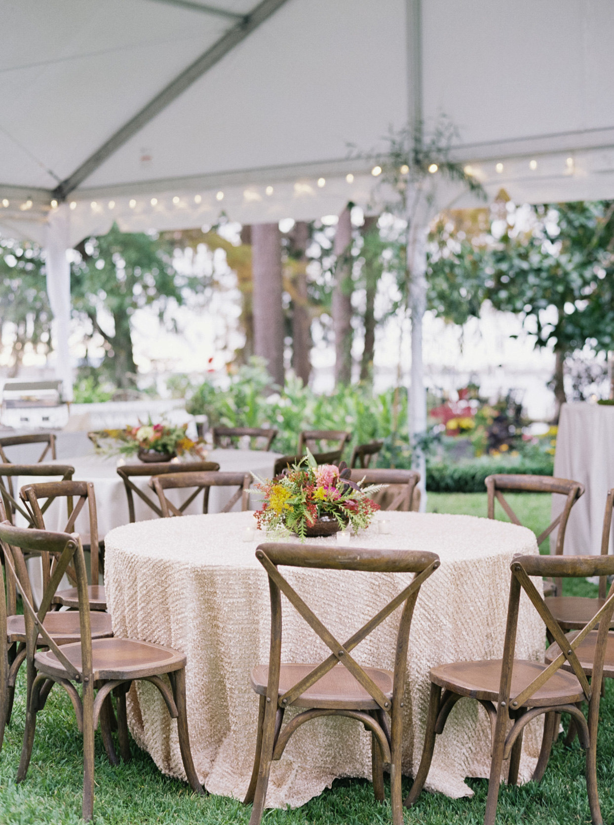 outdoor round wedding tables with wooden chairs