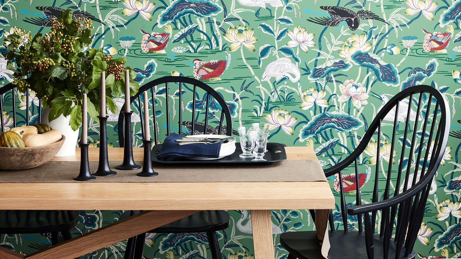 dining room furniture in forefront of wallpaper