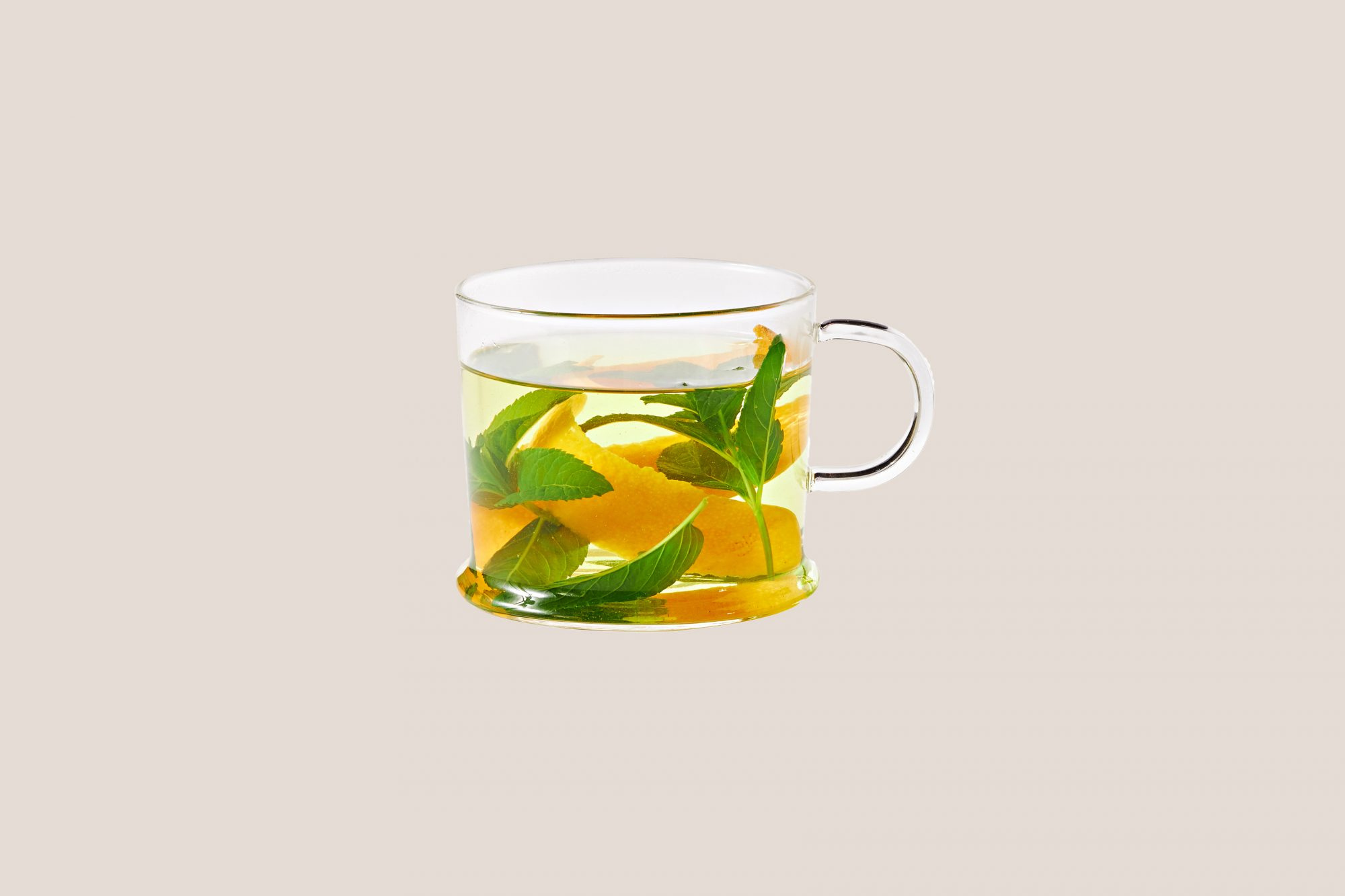 orange and mint tea in glass