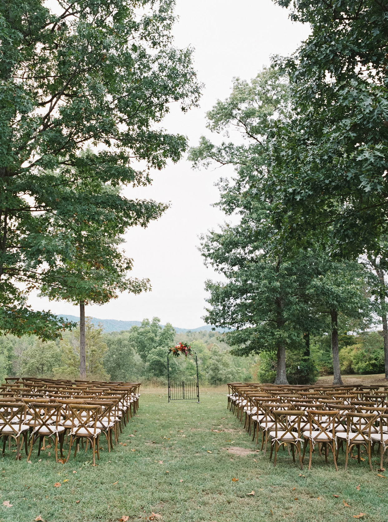 outdoor wedding ceremony wooden chairs seating