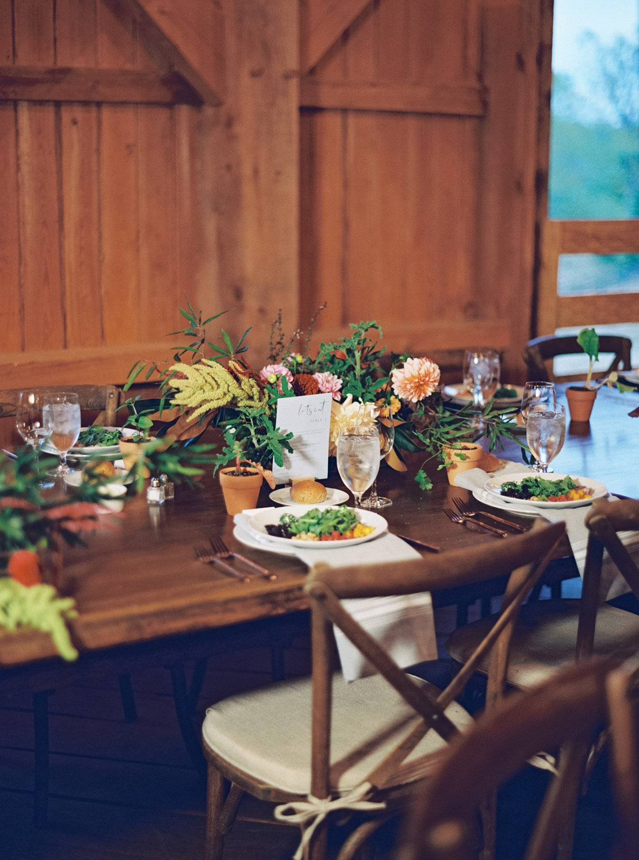 various green foliage with floral centerpiece reception table decor