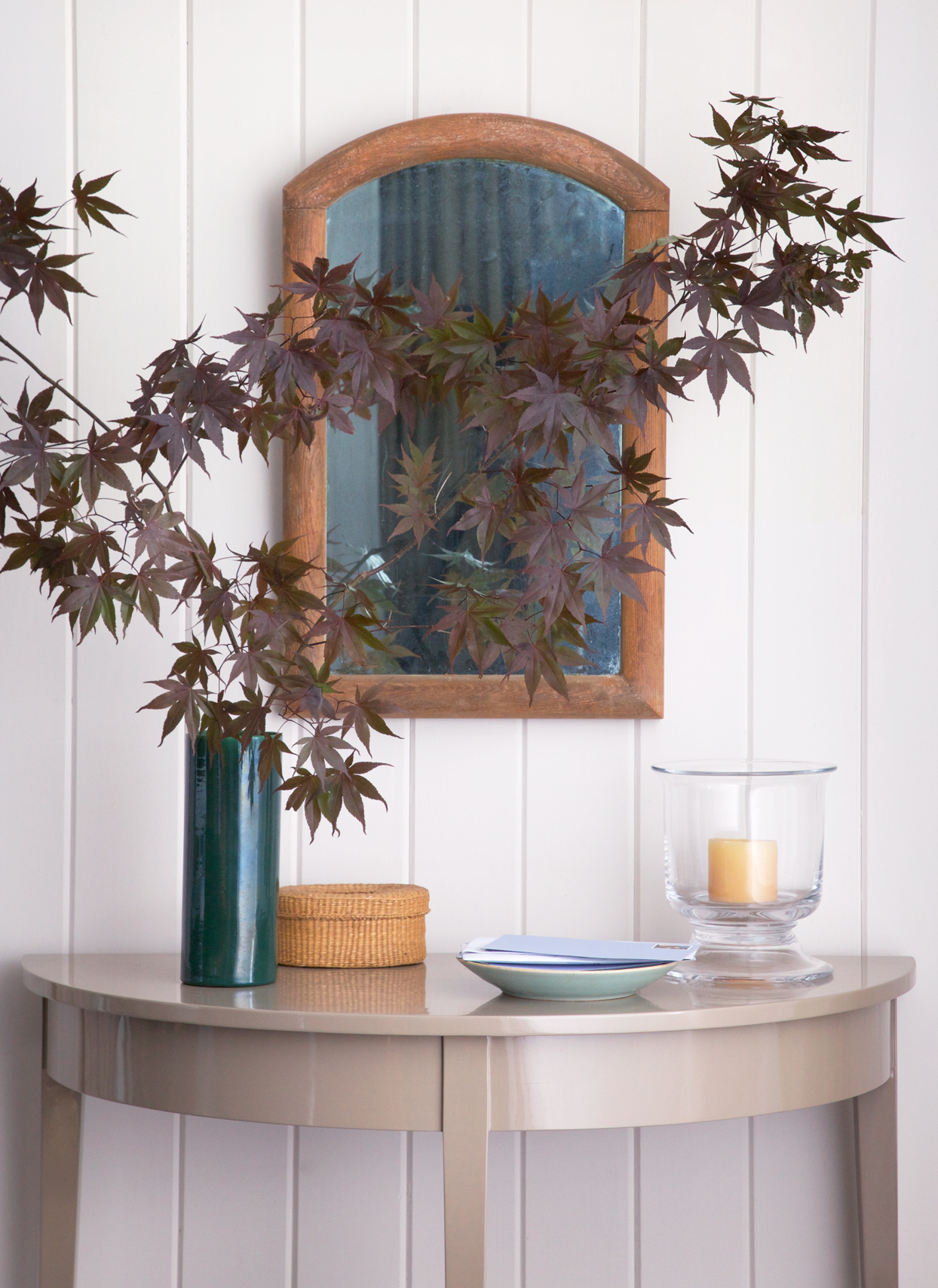entryway with mirror and table decor