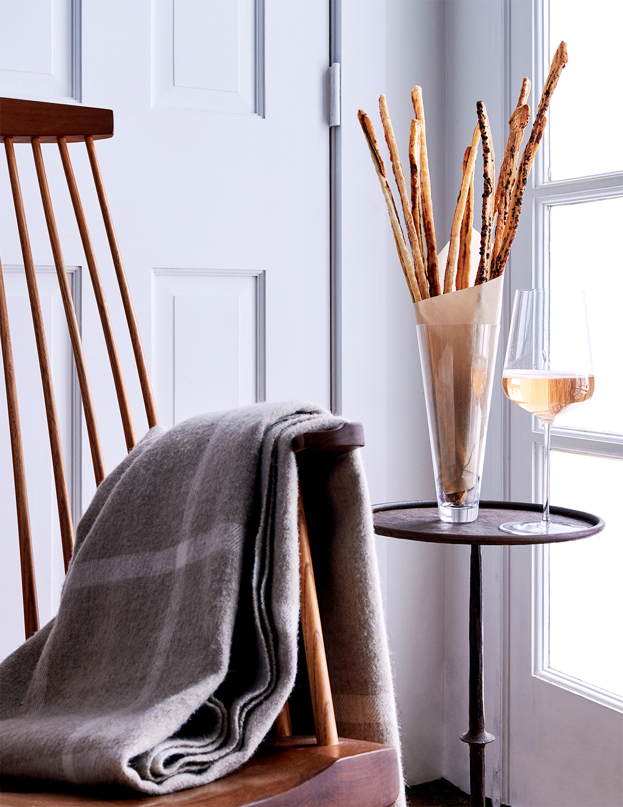 gruyere anchovy and olive straws within glass vase