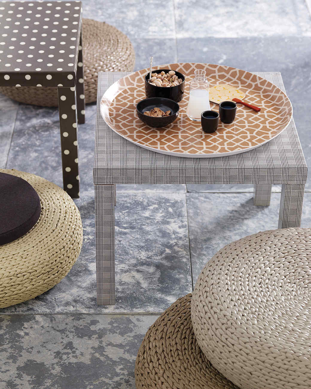 oilcloth tables and rattan poufs