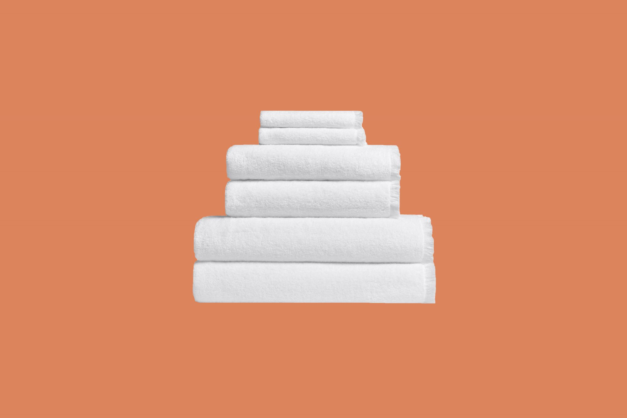 white cotton linen towels in a stack