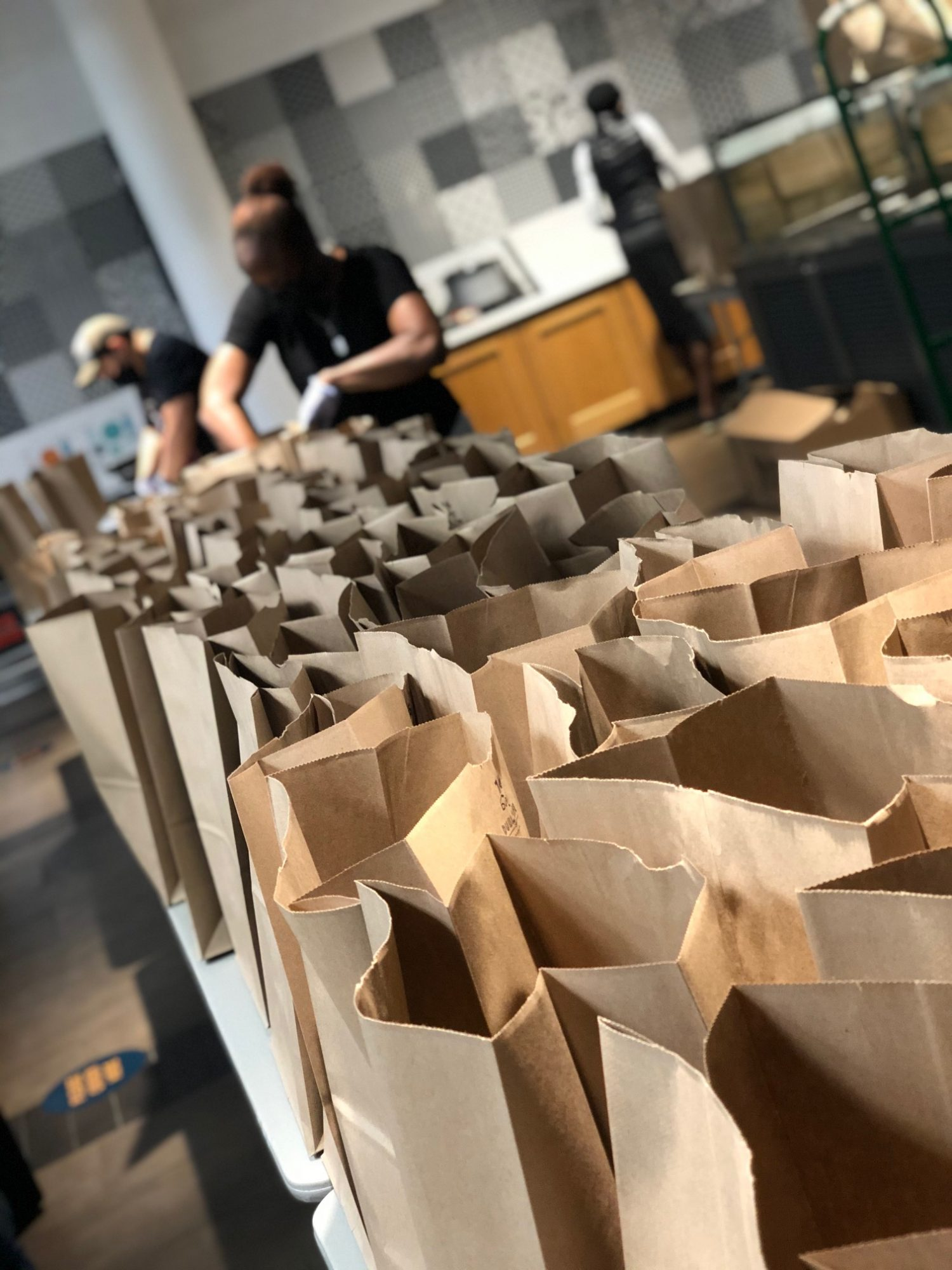workers filling bags for Full Heart Full Bellies