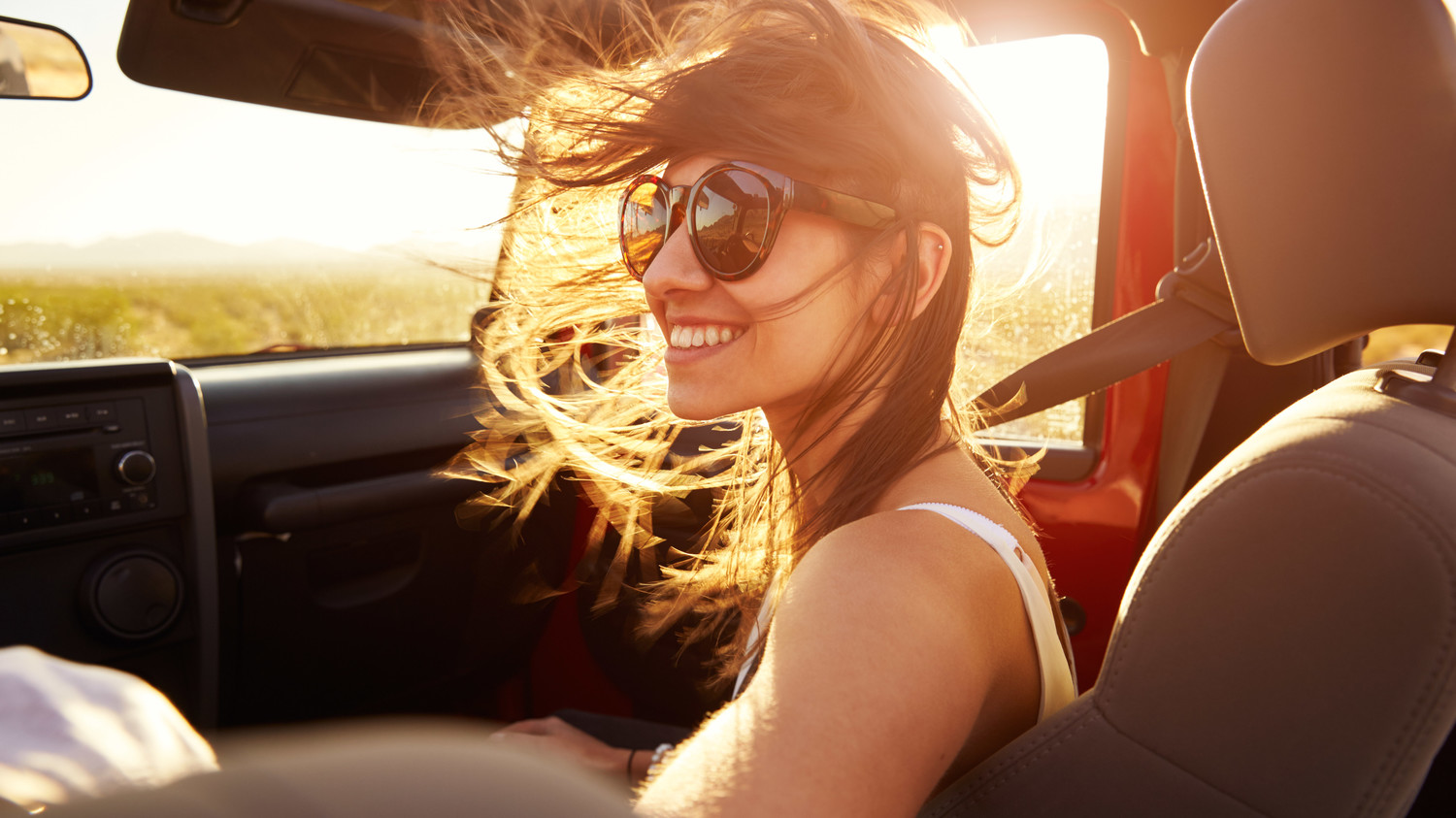 woman in car hair blowing in wind
