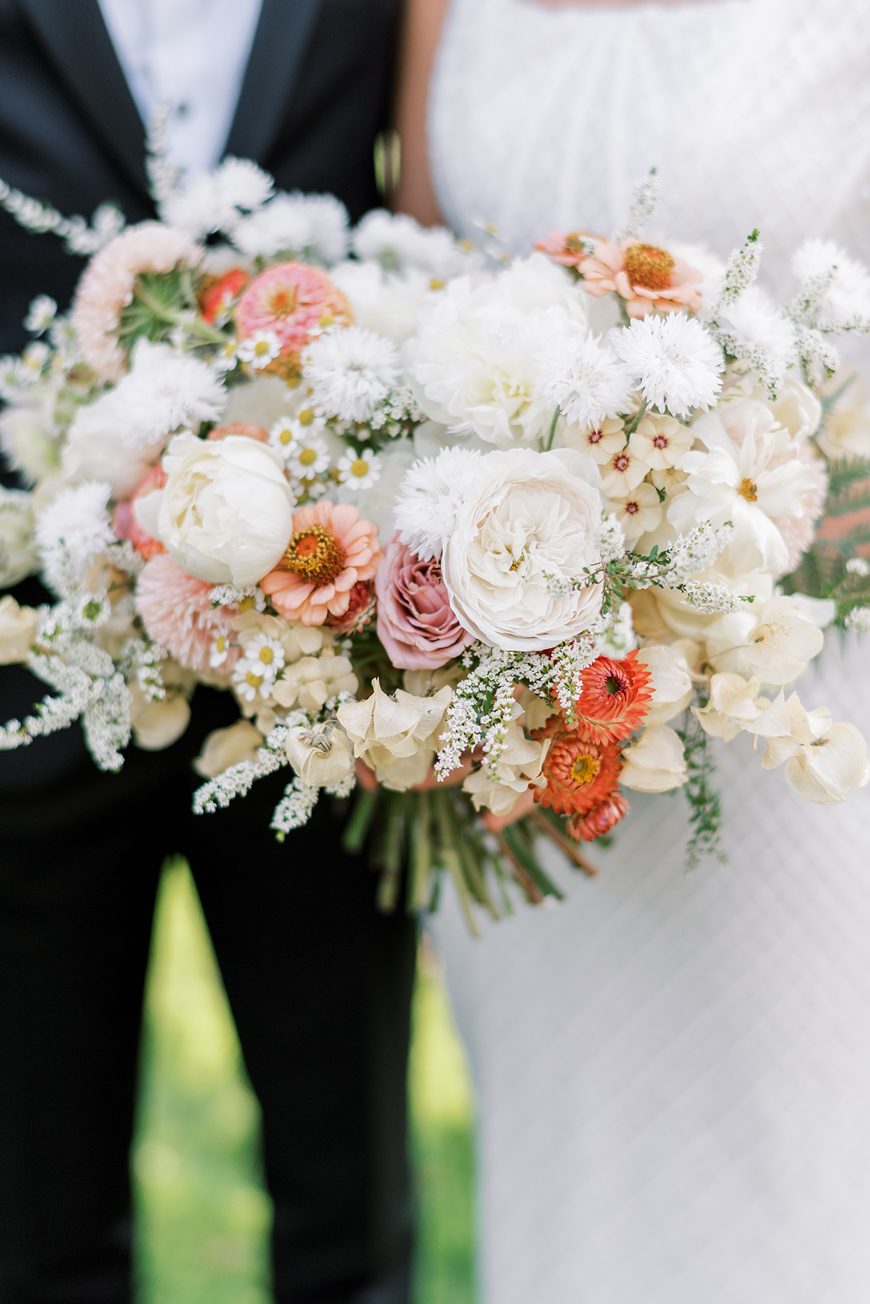 white with warm toned pops of color floral wedding bouquet