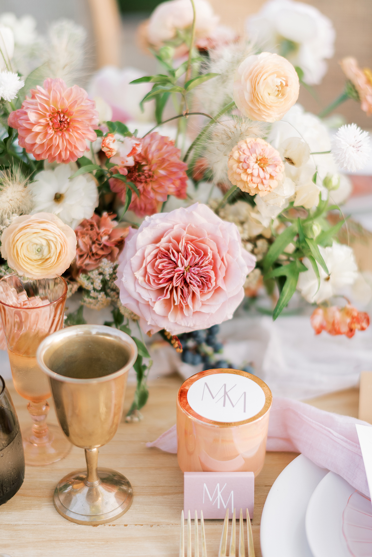 warm toned floral wedding reception table details