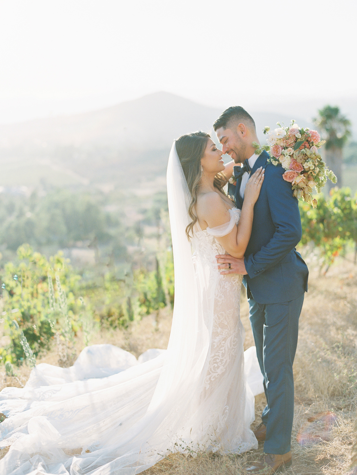 wedding couple portrait on hillside with mountain view