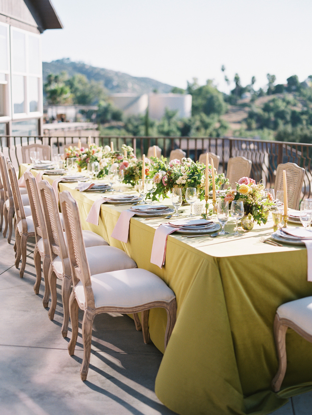 elegant wedding long table outdoors with flowers and candles