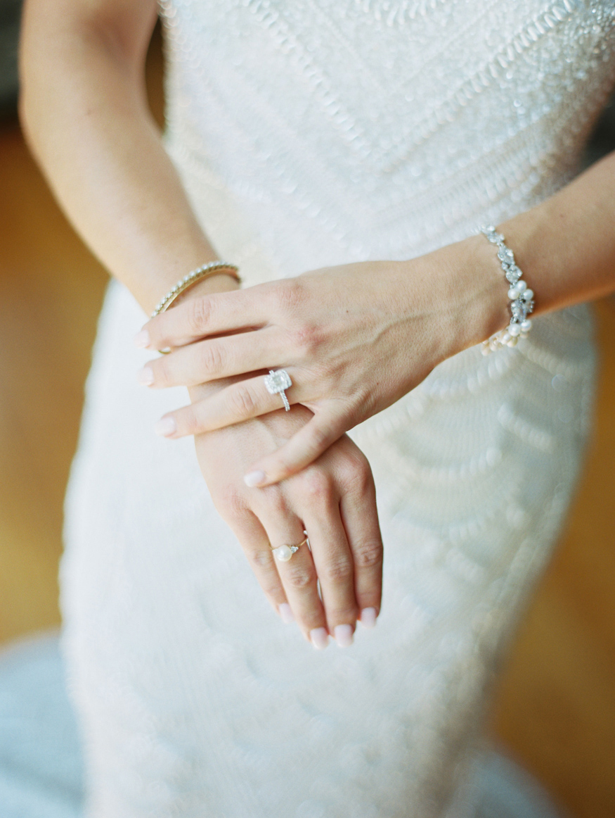 bride wearing bracelets and rings