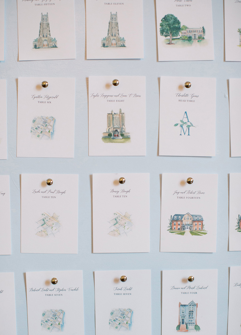 watercolor drawing escort cards pinned to board