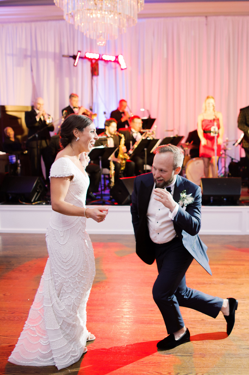 bride and groom sharing first dance during reception