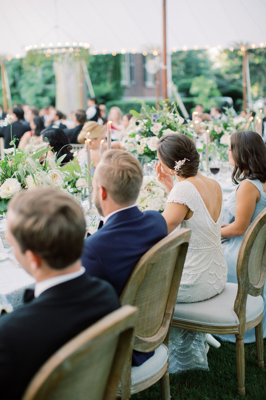 wedding party sitting at reception table