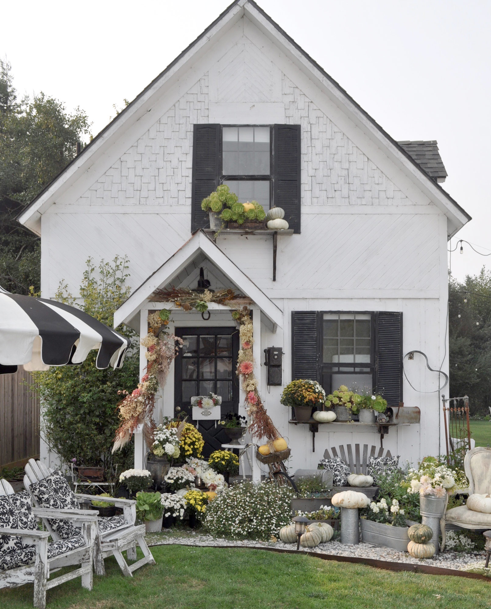white house fall porch with bright flowers